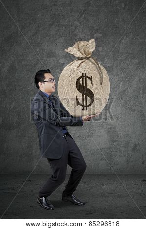 Male Banker Carrying A Money Sack
