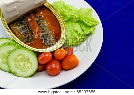 Canned Sardine Fish In Tomato Sauce Served On Dish With Salad