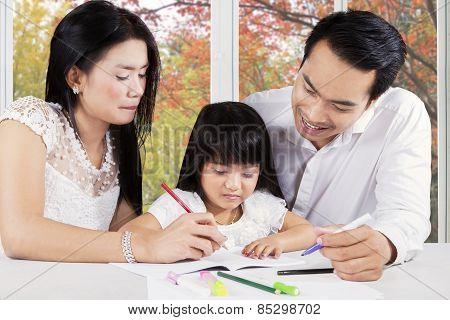 Modern Family Doing Homework On Table