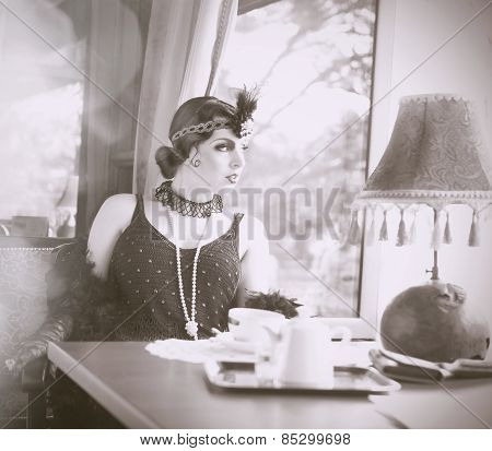 Find Similar  Get A Comp  Save To Lightboxretro Woman 1920S - 1930S Sitting With Cup Of Tea