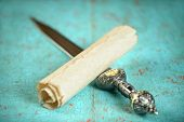 foto of scroll  - Vintage scroll and Roman sword on old table  - JPG