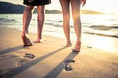 picture of legs feet  - Couple of lovers walking on the each at sunset  - JPG