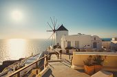 picture of windmills  - The famous Santorini Island in Greece - JPG