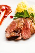 stock photo of roast duck  - roasted duck breast on Christmas table - JPG