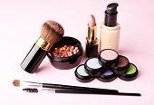 stock photo of decorative  - Set of decorative cosmetics on light colorful background - JPG