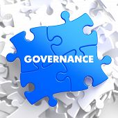 foto of puzzle  - Governance on Blue Puzzle on White Background - JPG