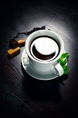 picture of black tea  - Still black tea and candies on black background - JPG
