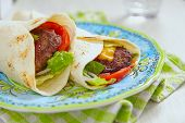 picture of beef-burger  - Fresh tortilla wrap with grilled beef burger and vegetables - JPG