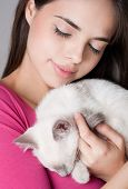 pic of siamese  - Gorgeous young brunette holding sweet young siamese kitten - JPG