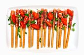 image of collate  - grissini sticks bacon tomatoes and basil food aperitif - JPG