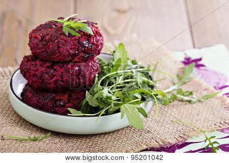 Beetroot vegan burgers with rice and beans