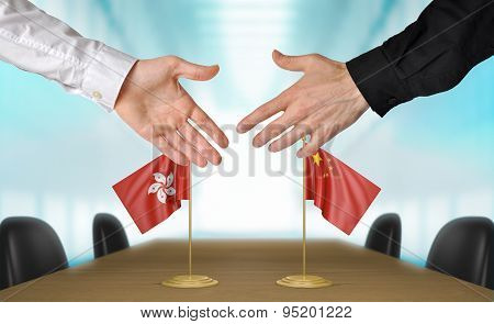 Hong Kong and China diplomats agreeing on a deal