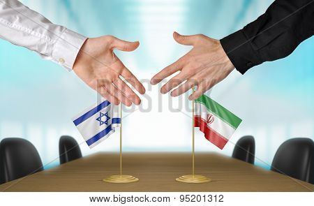 Israel and Iran diplomats agreeing on a deal