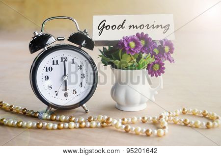 Alarm Clock And Good Morning Tag With Violet Flower.
