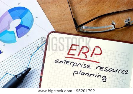 Notepad with Enterprise Resource Planning System (ERP).