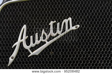 A name badge on a classic car