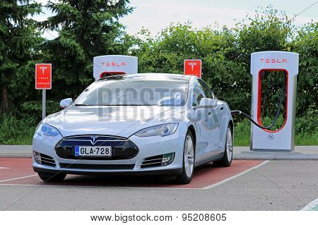 Tesla Model S At Supercharger Station