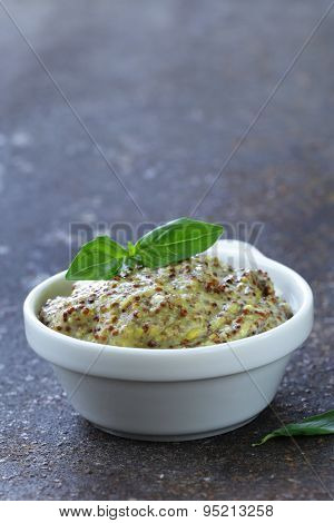 traditional yellow mustard sauce in a white bowl
