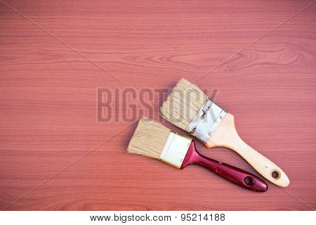 Paint Brushes On A Wooden Background