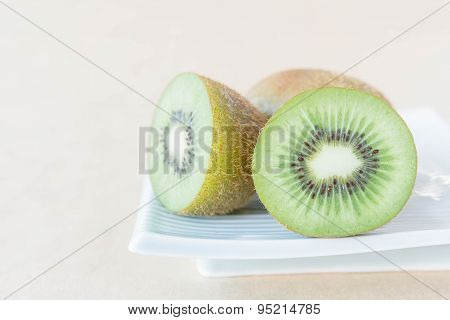 Whole Kiwi Fruit And His Sliced Segments.
