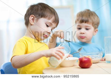 Children Eating Healthy Food In Kindergarten Or Nursery