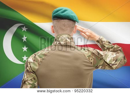 National Military Forces With Flag On Background Conceptual Series - Comoros