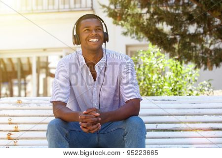 Young Man Smiling Outside With Headphones