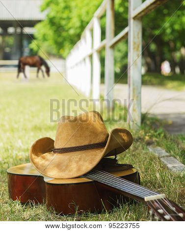 American Ranch With Cowboy Hat And Guitar