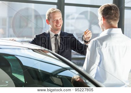 Salesman Giving Car Key