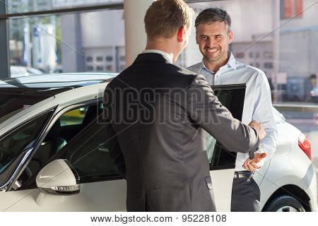 Mature Man Buying New Car