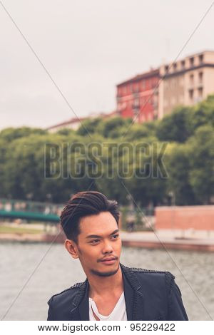 Handsome Asian Model Posing By An Artificial Basin