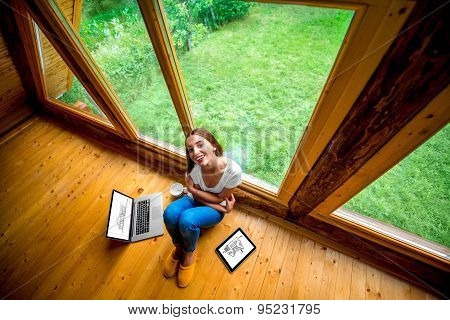 Woman sitting on the floor in wooden house