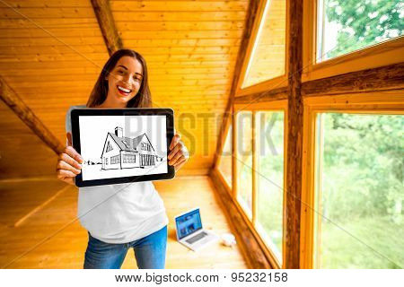 Woman showing digital tablet in the wooden house