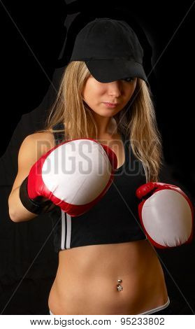 Beautiful girl in boxing gloves