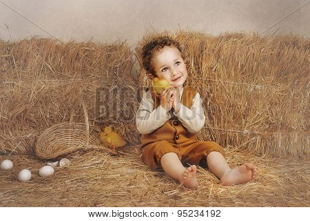 Beautiful Curly-haired Boy Sitting Next To A Hay Duckling Ear