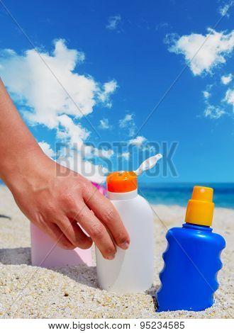 Girl Holding A Suntan Bottle