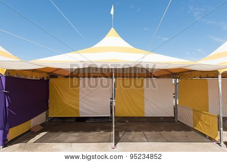 Yellow And White Striped Tent Outdoors