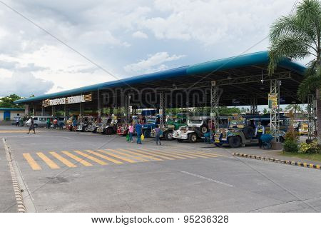 NAGA CITY, PHILIPPINES - JUNE 3, 2015: Colorful jeepneys at a jeepney terminal. Jeepneys are the most popular means of public transportation in the Philippines.