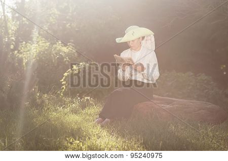 Woman In Old-fashioned Dress Reading Book