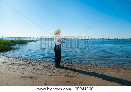Woman With Fan On The Coast