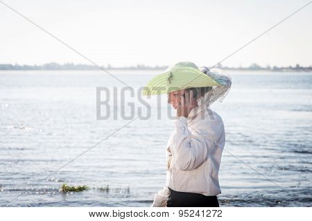 Woman With Phone On The Coast