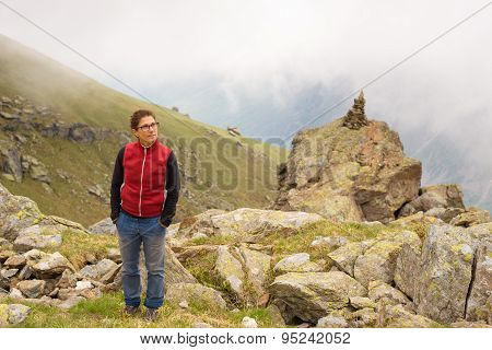 Woman Standing On The Mountain Summit