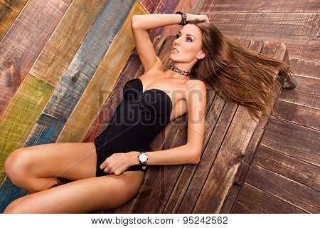 Sexy Girl Lying On The Wooden Floor
