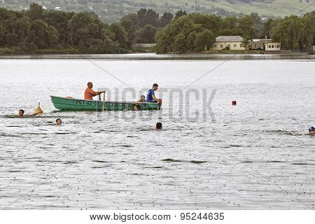 Rescuers In A Boat.