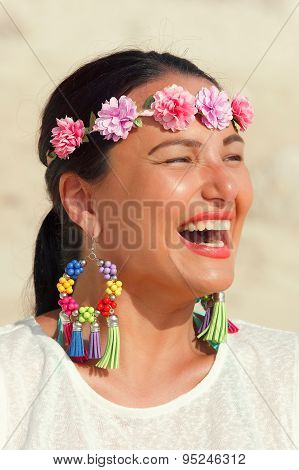Beautiful woman smiling on the beach, close up