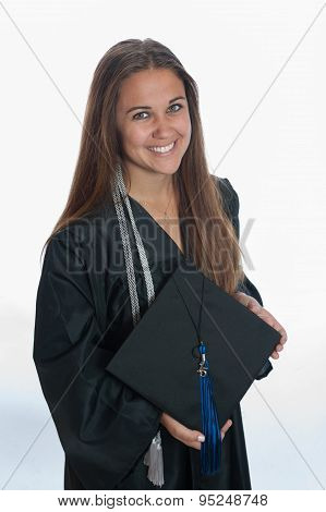 Showing her cap and tassel