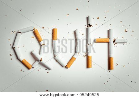 Broken cigarettes arranged as a word quit