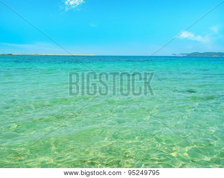 Crystal Clear Water On A Sunny Day In Alghero
