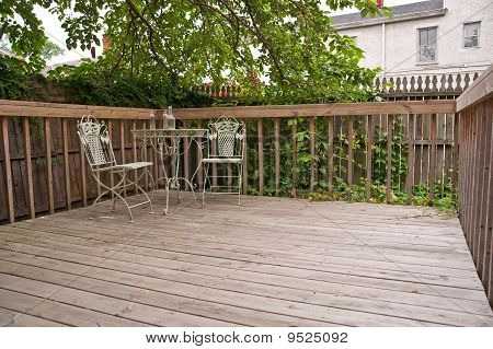 Weathered Deck And Vintage Bistro Table