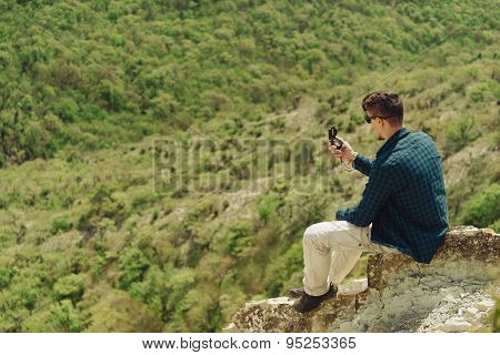 Traveler Man Searching Direction With A Compass Outdoor